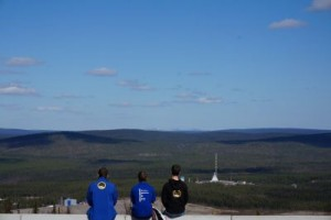 Three teammembers observing launch from Radar hill at Esrange.